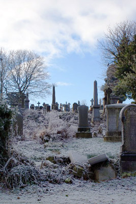 gravestones covered in frost in a Scottish cemetery